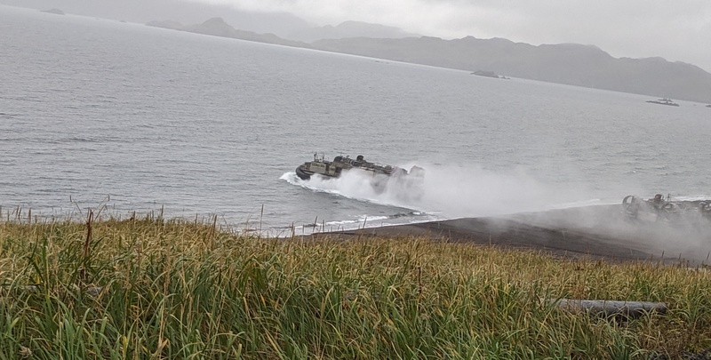 Marine hovercraft leaving NavFac Beach, heading out to the mothership (note the other hovercraft still on the beach).